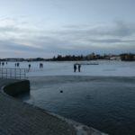 People walking on frozen pond