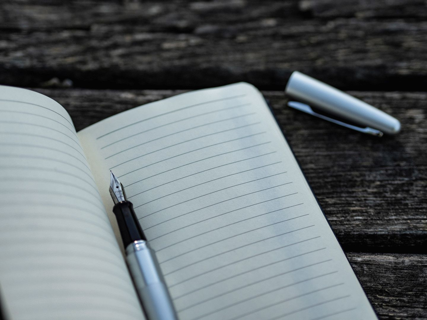 A blank notebook with fountain pen